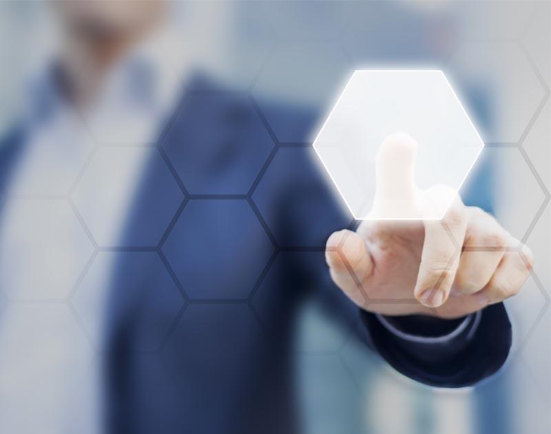 Person touching an hexagonal button on a digital interface